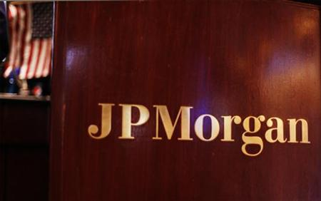 Flag hangs on the wall of the JP Morgan company stall on the floor of the New York Stock Exchange in New York