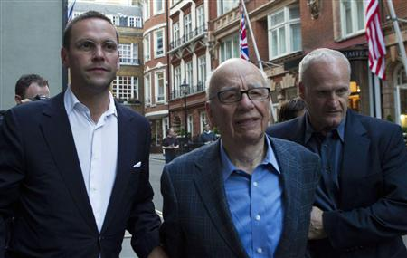 James and Rupert Murdoch and a minder leave the Stafford Hotel in St James's Place, central London