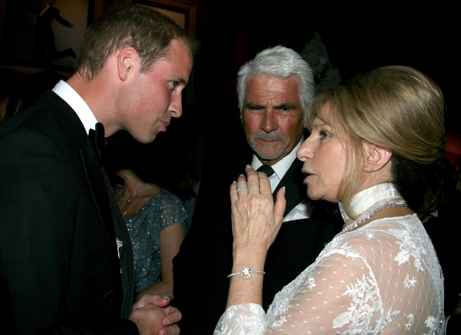 Britain's Prince William speaks to actress Barbra Streisand and her husband James Brolin at the BAFTA Brits to Watch event in Los Angeles