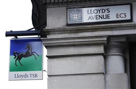 A sign for LloydsTSB bank hangs on the corner of Lloyd's Avenue in the City of London
