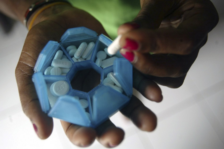 Woman prepares HIV/AIDS drugs