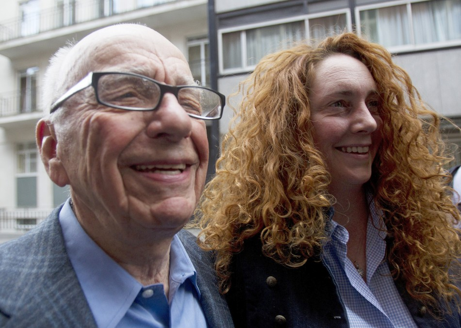 News Corporation CEO Rupert Murdoch leaves his flat with Rebekah Brooks, Chief Executive of News International, in central London