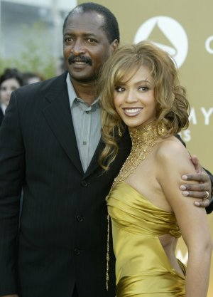 Singer Beyonce Knowles with her father Matthew Knowles