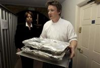 Celebrity chef Jamie Oliver carries out food for a G20 leaders dinner at Downing Street in London