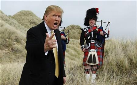 U.S. property mogul Trump gestures during a media event on the sand dunes of the Menie estate
