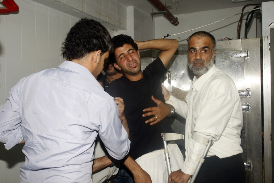 Relatives of Sarhan mourn at the hospital morgue in Nablus