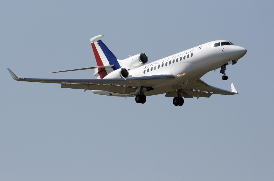 A French presidential plane, with tri-colour tail insignia, thought to carry France's President Nicolas Sarkozy, prepares to land at the military air base of Solenzara in Corsica