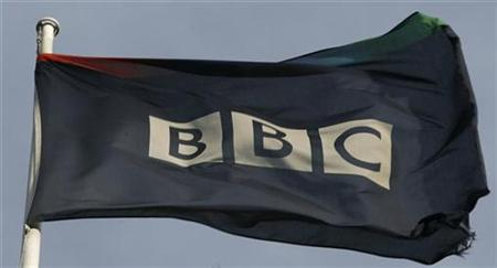 A tattered flag flies in a strong breeze above the BBC headquarters in London