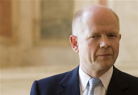 Foreign Secretary Hague looks on during a joint news conference with his Italian counterpart Frattini at the end of a meeting at Villa Madama in Rome