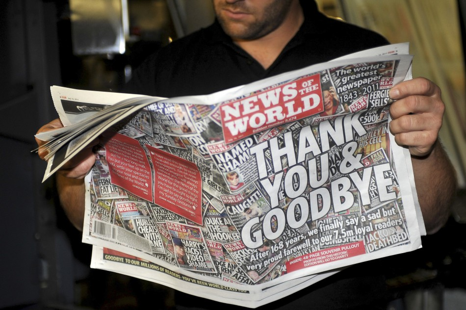 Printer Jamea Bradley looks at final copy of News of the World
