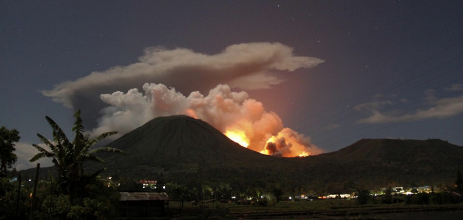 Central Indonesian Volcano Erupts Spewing Hot Lava, Thousands Flee.
