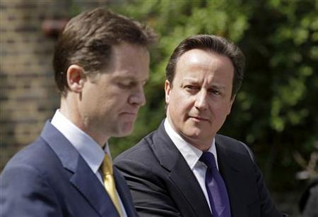 Britain's Prime Minister Cameron and Deputy Prime Minister Clegg hold their first joint news conference in London