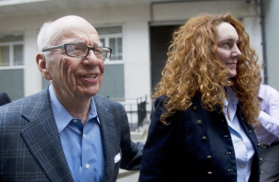 News Corporation CEO Rupert Murdoch leaves his flat with Rebekah Brooks
