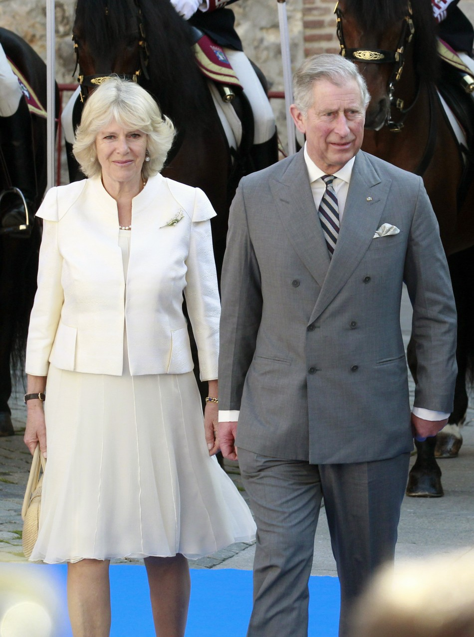 Britain's Prince Charles walks next to his wife Camilla