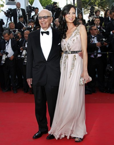 News Corp CEO Murdoch and his wife arrive on the red carpet at the 64th Cannes Film Festival