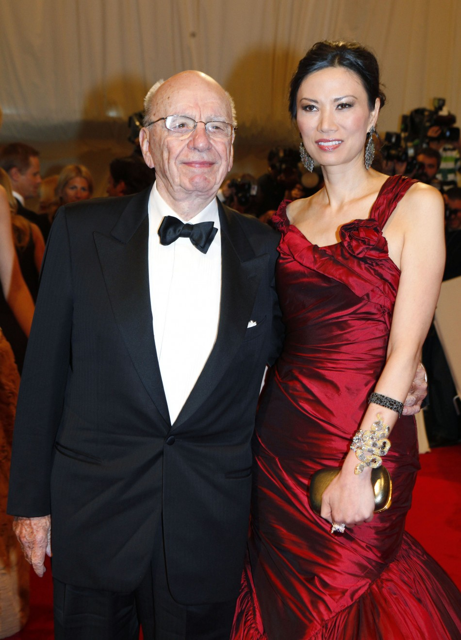 Rupert Murdoch and wife Wendi Deng Murdoch pose on the red carpet at the Metropolitan Museum of Art Costume Institute Benefit celebrating the opening of Alexander McQueen Savage Beauty in New York