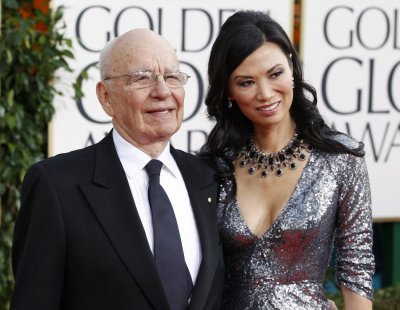 News Corp Chief Executive Rupert Murdoch and his wife arrive at the 68th annual Golden Globe Awards in Beverly Hills
