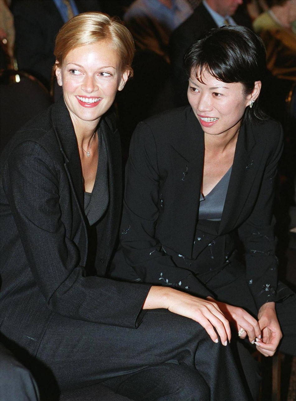 Wendi Deng R, wife of News Corp Limited Chairman Rupert Murdoch, talks with Sarah OHare,