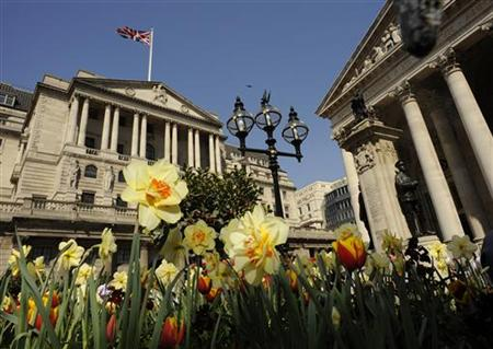 The Bank of England is seen behind blossoming flowers in the City of London