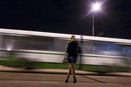 A prostitute waits for clients on a street in the outskirts of Moscow