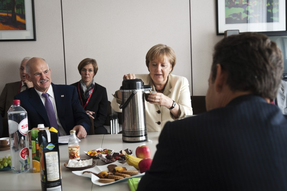 German Chancellor Merkel Greek Prime Minister Papandreou and French President Sarkozy attend a meeting in Brussels