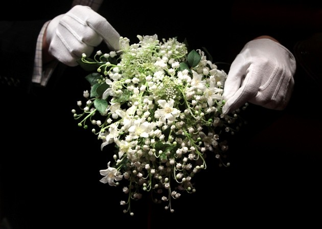 A recreation of the wedding bouquet of Britain's Catherine, Duchess of Cambridge is seen as it is prepared for display at Buckingham Palace in London