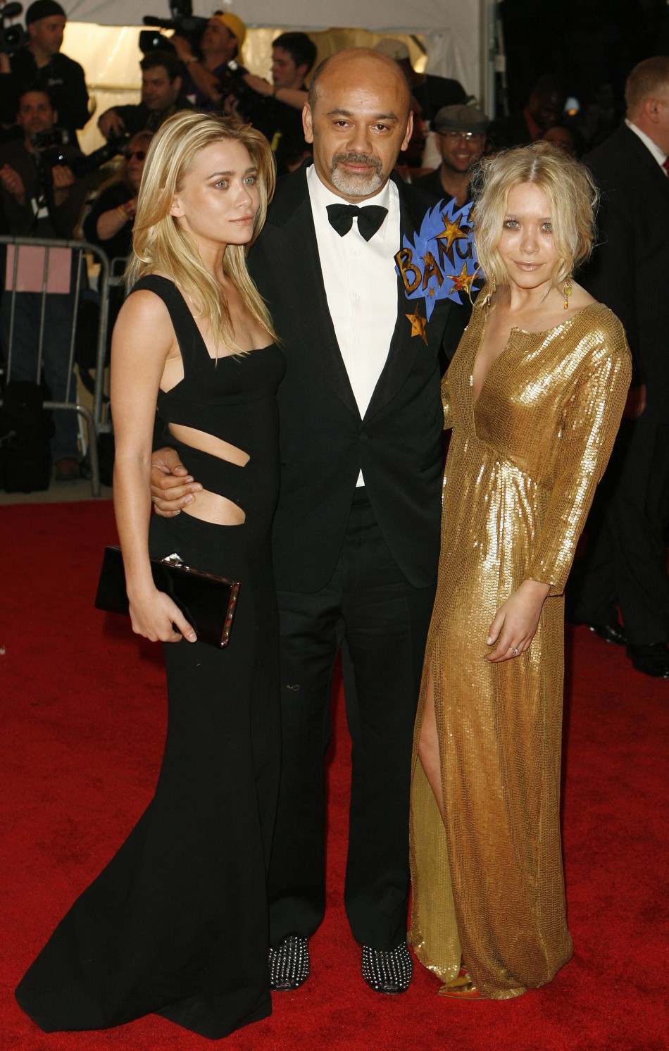 Actress Ashley Olsen, designer Louboutin and actress Mary Kate Olsen arrive for the Metropolitan Museum of Art Costume Institute Gala in New York