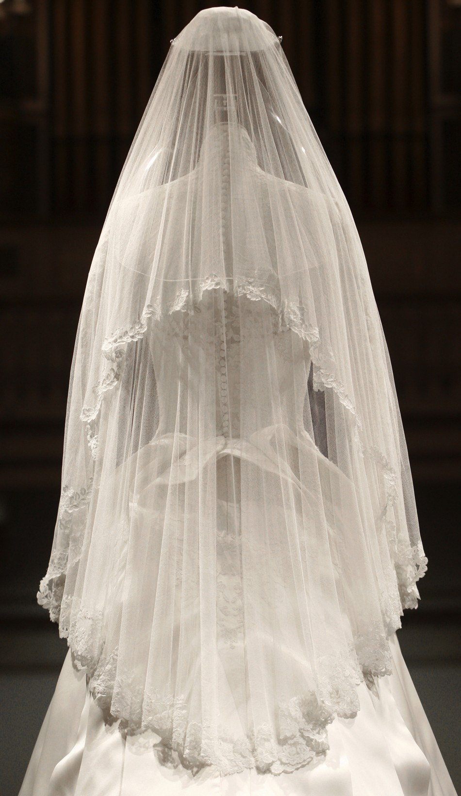 The wedding dress of Britain039s Catherine, Duchess of Cambridge is seen as it is prepared for display at Buckingham Palace in London