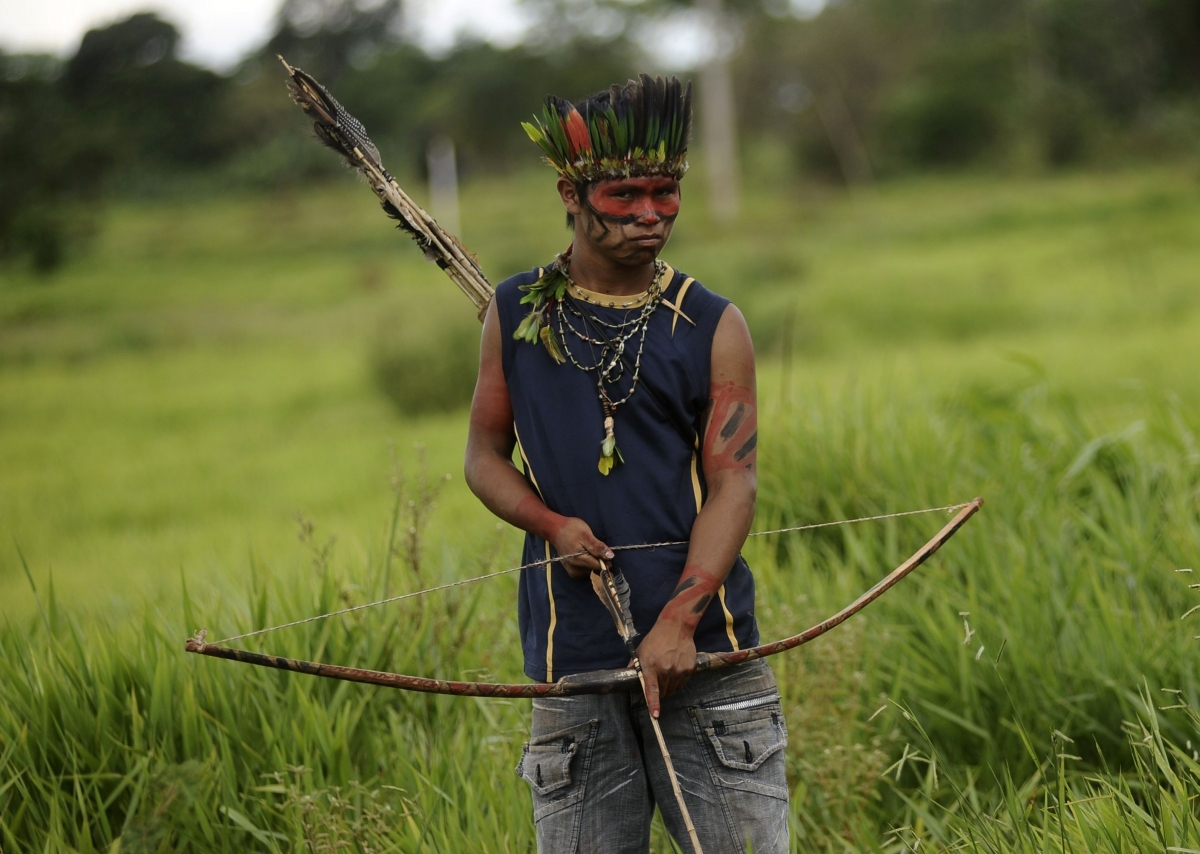 A member of the Guarani tribe watch at a roadblock they built to keep farmers out after they occupied a farm they claim is part of their ancestral land in Mato Grosso do Sul state, Brazil. (Reuters)