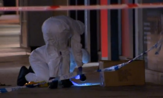Police forensic team comb area in Cornmarket, Belfast targeted by a firebomber