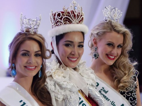 Newly crowned Miss International 2013 Bea Rose Santiago of the Philippines (C), first runner-up Miss Netherlands Nathalie den Dekker (L) and second runner-up Miss New Zealand Casey Radley.