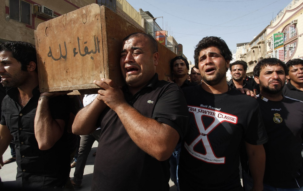 Shiite Muslims Mourn Suicide Bomb Deaths