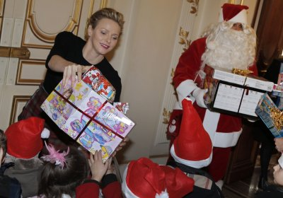 Princess Charlene distributes gifts to children as part of Christmas holiday season.