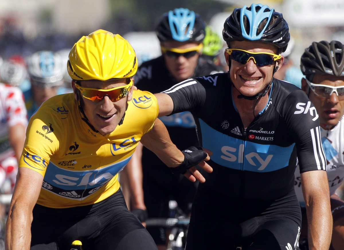 Michael Rogers congratulates team mate Bradley Wiggins on his victory in final stage of Tour de France