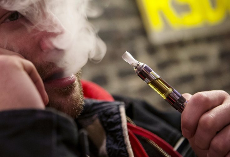 Man enjoys e-cigerette in New York, containing nicotine and not tar