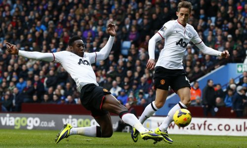 Danny Welbeck attacks the ball