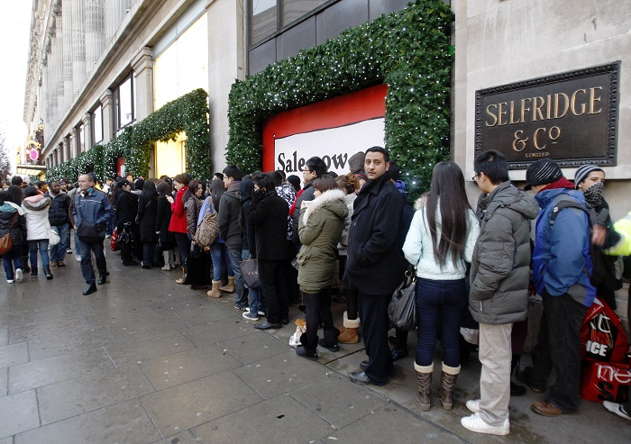 Shoppers queue outside Selfridges on London's Oxford Street.