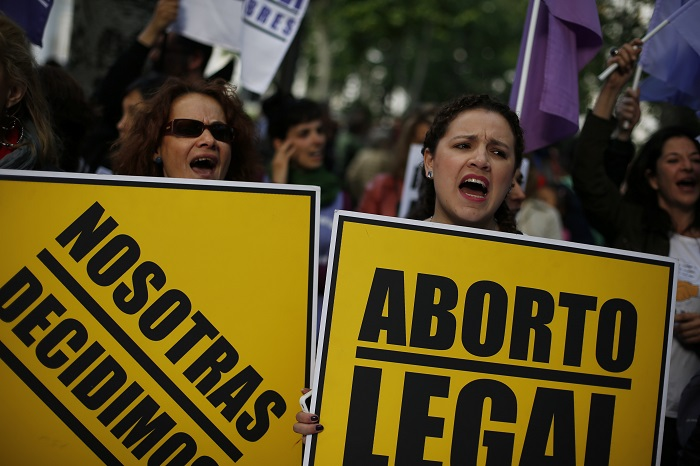 Demonstrators shout slogans during a pro-choice protest against Spain's anti-abortion draft bill.