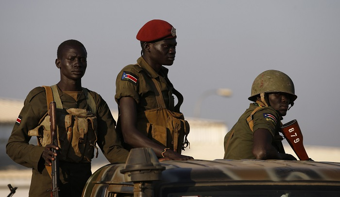 South Sudan government soldiers stand guard in Juba. Current inter-ethnic clashes have been blamed on disputes between Dinka and Nuer members of the presidential guard.