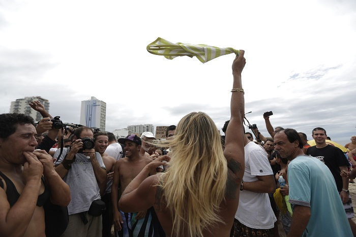 Protesters say the ban on topless sunbathing is old-fashioned and hypocritical.