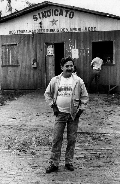 Chico Mendes stands outside the headquarters of his rubber tappers' union in the Amazonian city of Xapuri, Acre state, in December 1988.