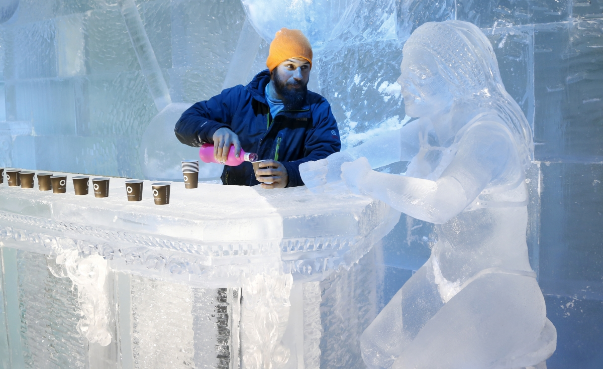 The Ice Maiden Cometh. Sculptor Jonathan Bouchard of Canada poses near a sculpture at the ice bar of the Brussels Ice Magic Festival. Some 20 artists from all over the world made sculptures out of 420 tonnes of ice depicting characters from comic strips.