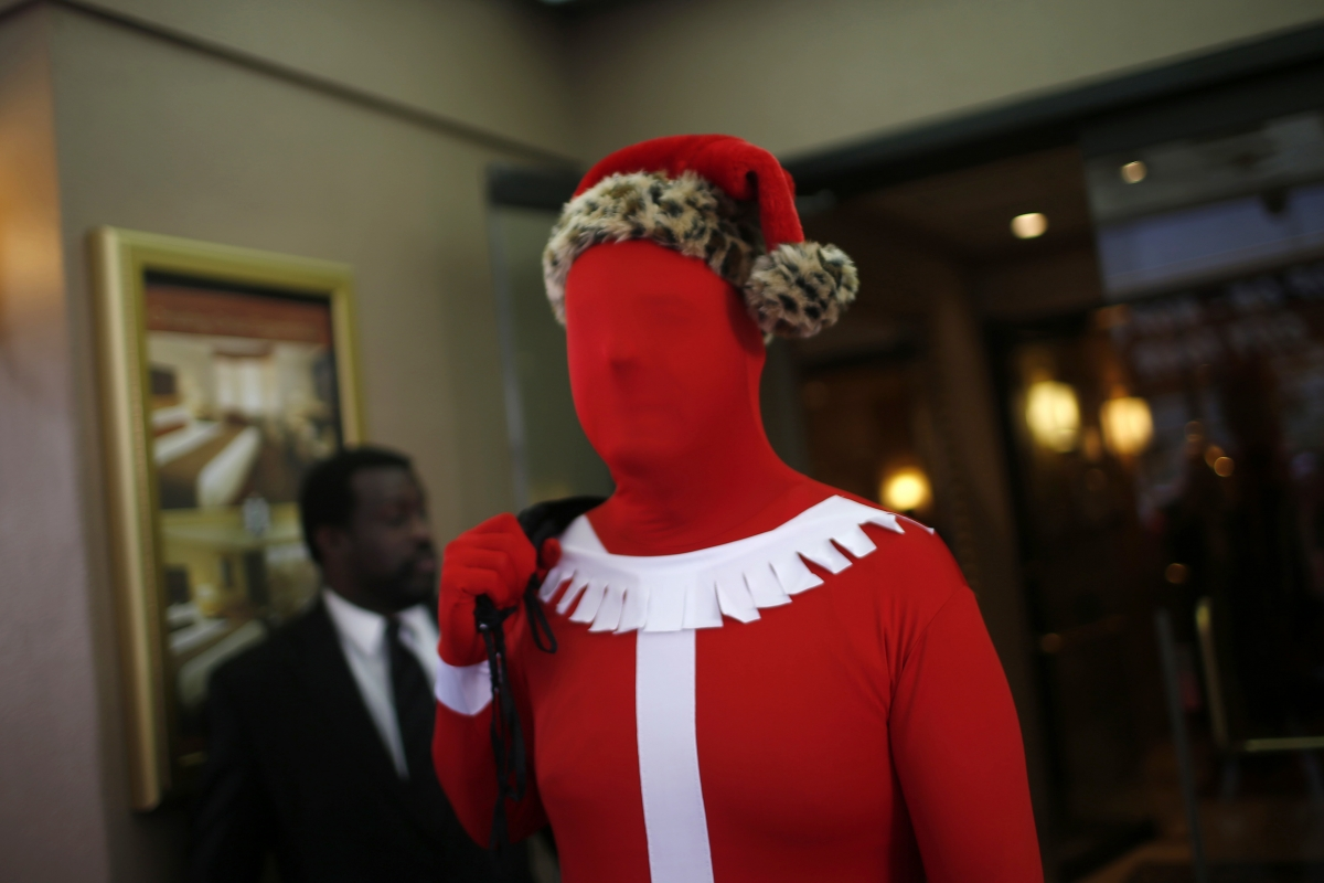 Creepy and disturbing but strangely festive. A fan of the Morphsuit at the annual SantaCon event in San Francisco.