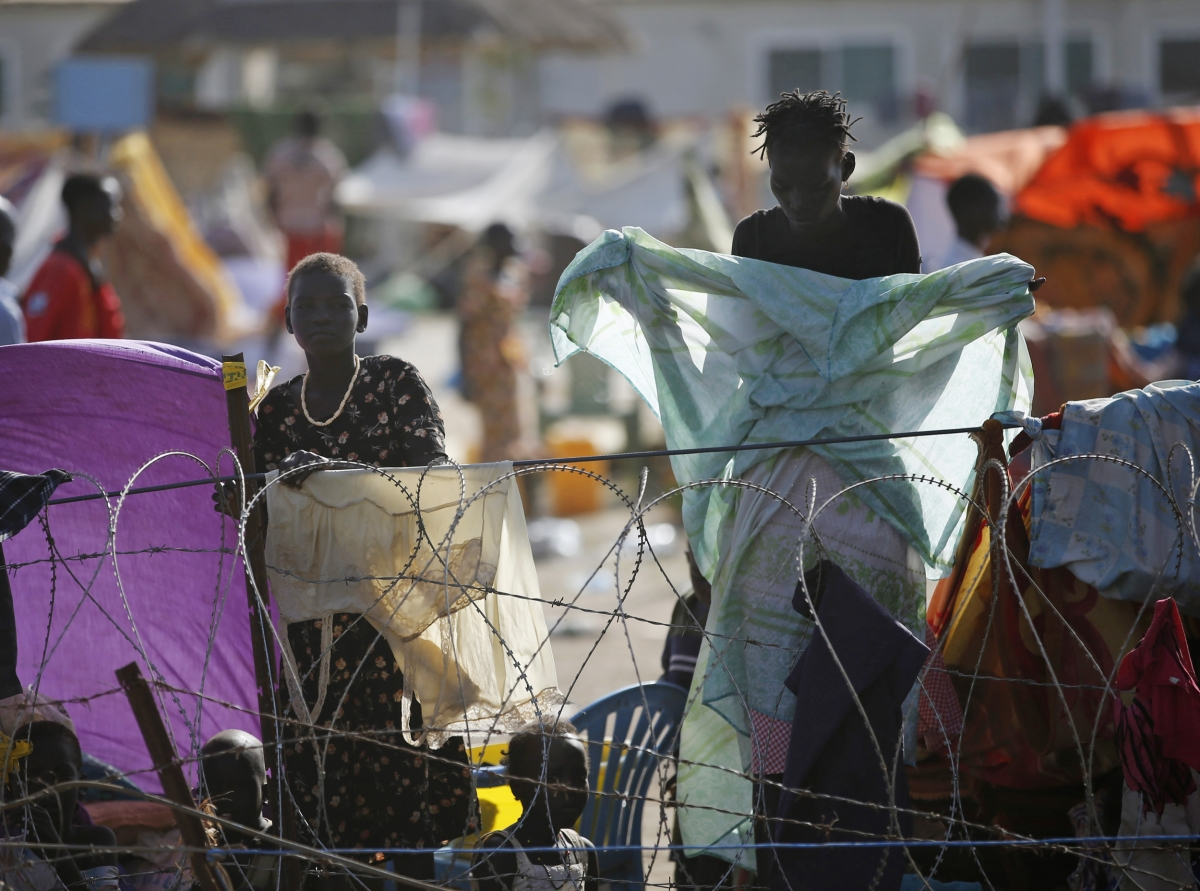 Internally displaced people stand inside a United Nations Missions in Sudan (UNMIS) compound in Juba, South Sudan.