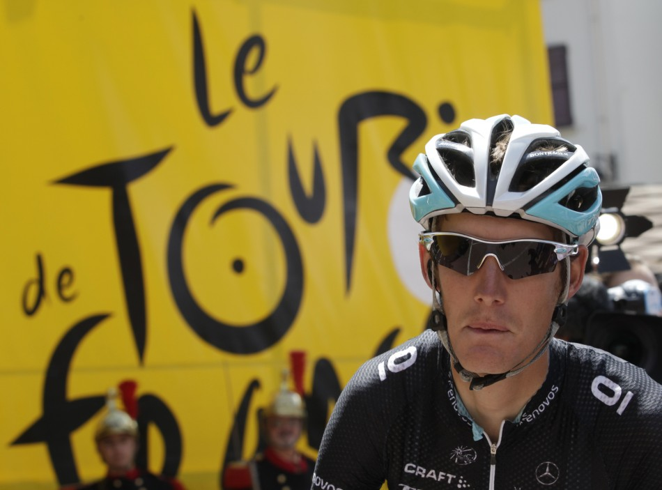 Leopard-Trek's Andy Schleck of Luxembourg prepares for the start of the 19th stage of the Tour de France 2011 cycling race from Modane to Alpe d'Huez