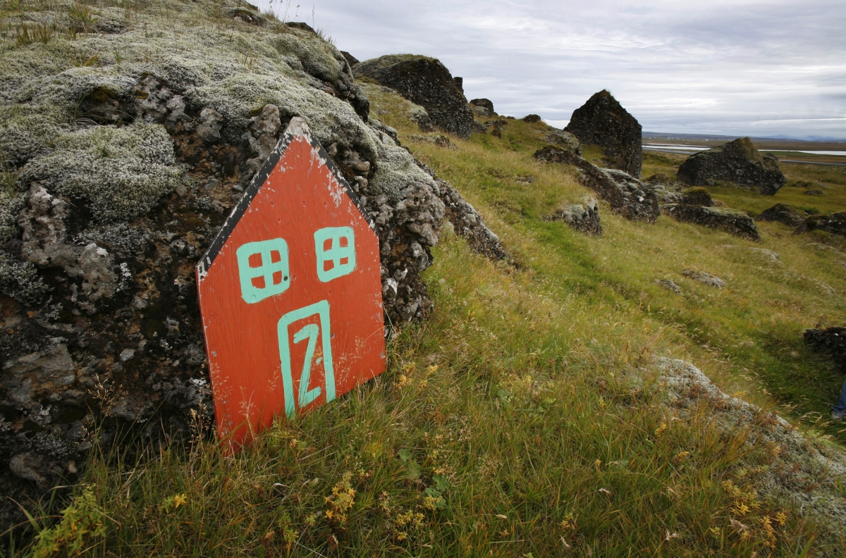 A painted elf door leans against rocks near the Icelandic town of Selfoss