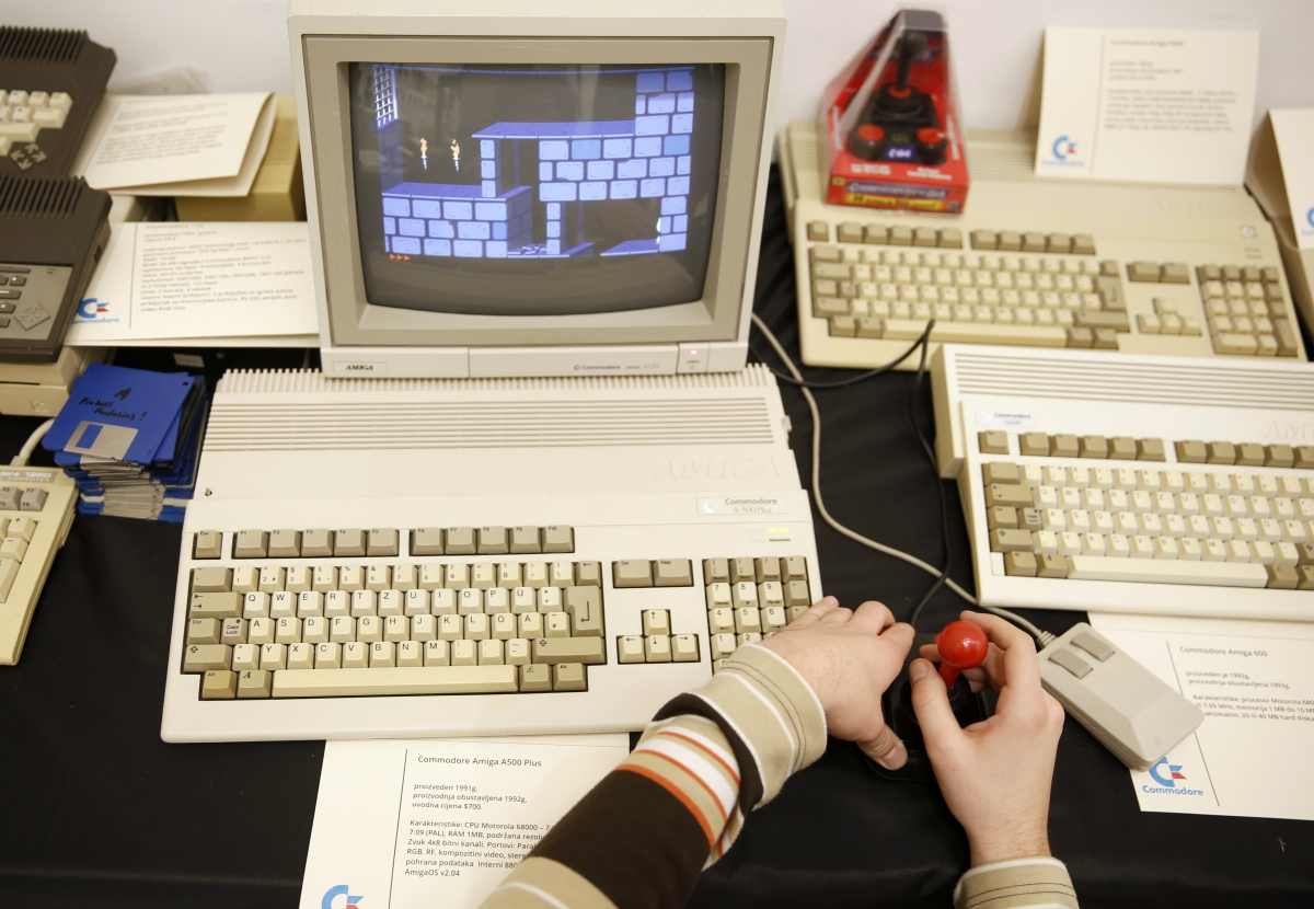 Boy plays a classic Commodore computer game.