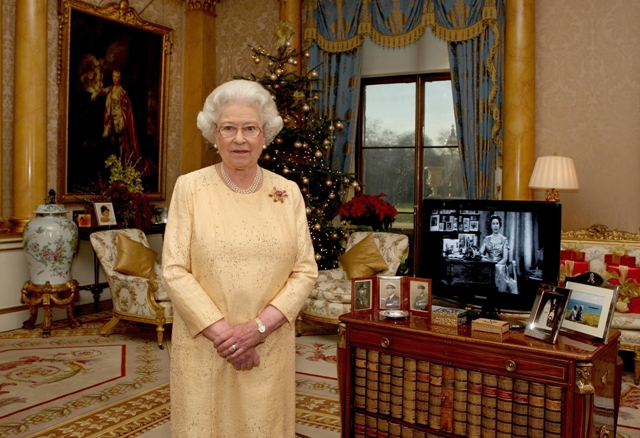 Queen Elizabeth poses as she records one of her earlier Christmas broadcast