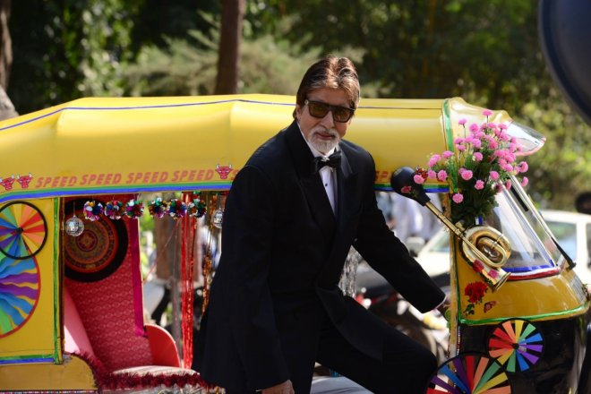 Amitabh Bachchan poses with auto rickshaw for Dabboo Ratnani calendar shoot in Mumbai.