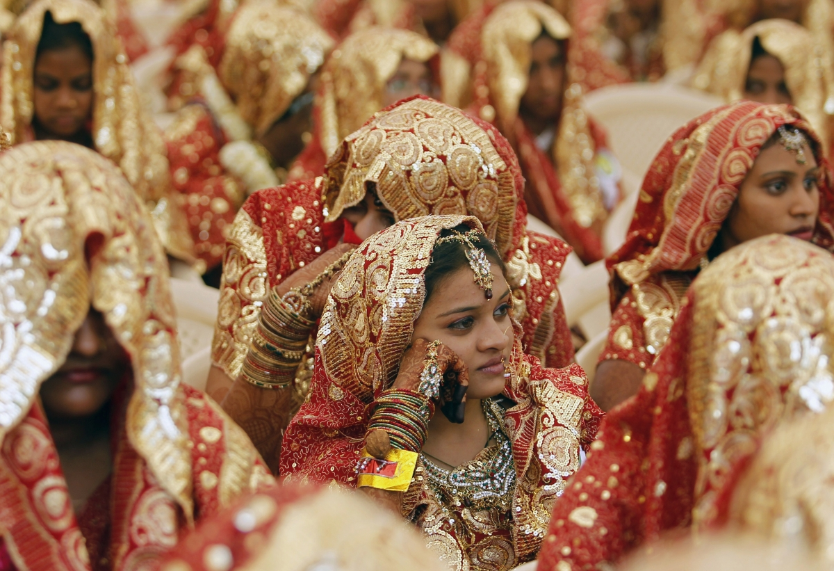 Brides wait for their weddings to start during a mass marriage ceremony in the western Indian city of Ahmedabad February 22, 2013.